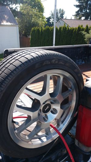 Stock mustang rims and tires 80% tread have all 4 for Sale in Everett, WA