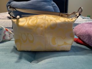 Small yellow coach purse for Sale in Clermont, FL
