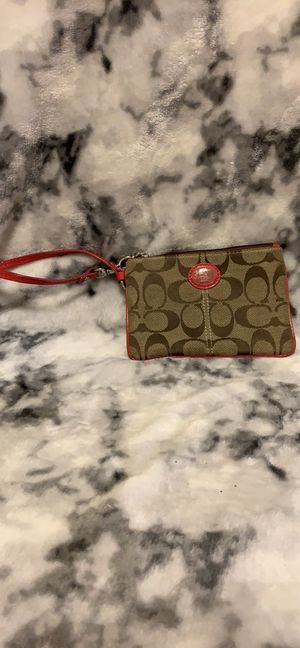 Used Pink/Brown Coach Wristlet for Sale in Fort Belvoir, VA