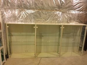 Three wood and glass cabinets for Sale in Boyds, MD