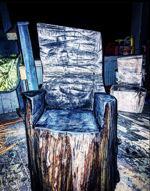 Beautiful log chair coated with ebony wood stain for Sale in Farmington, WV