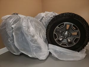 Jeep Wrangler Stock Rims + Tires (Great Condition) for Sale in Baltimore, MD