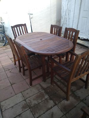 Teak wood dinette set and reclining chairs and trunk and rocking chair tables for Sale in Riverside, CA