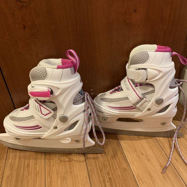 Girl ice skating skates