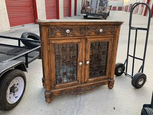 Wine cabinet very nice look at pics with storage glass shelves for Sale in San Bernardino, CA