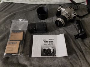 Canon EOS 300 w/ 2 lenses, filters and secondary battery handle for Sale in Denver, CO