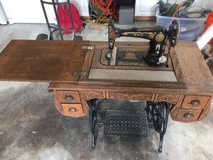 Antique sewing machine & cabinet for Sale in Alexandria, VA