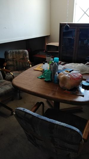 A wooden kitchen table and 4 chairs for Sale in Minneapolis, MN