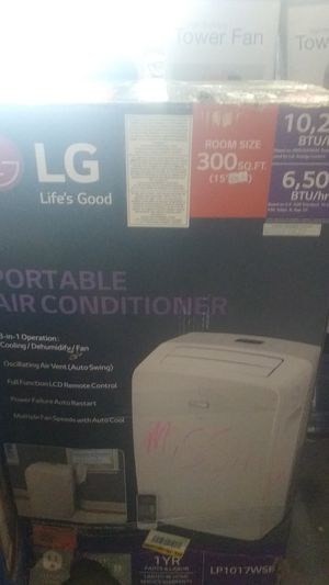 LG 10200 BTU portable air conditioner dehumidifier fan missing a portion of the window kit otherwise brand new for Sale in Riverside, CA