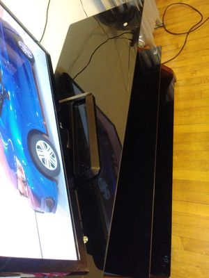 Glass TV stand holds up to 70 inch TV all black glass for Sale in Chicago, IL