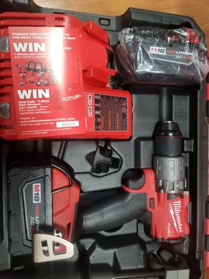 Milwaukee full hammer drill driver 2 battery 5.0 for Sale in Chicago, IL