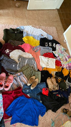 Women's clothing, shoes(sz 7-8 ), swimsuits. Sizes vary from xs-large for Sale in Garland, TX