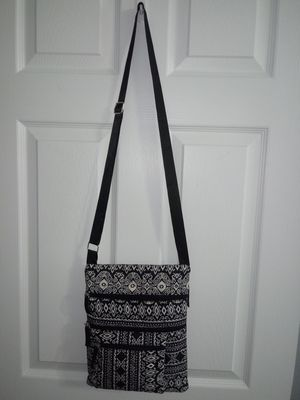 Like New lightweight crossbody purse with many zipper pockets..black and white for Sale in Kernersville, NC