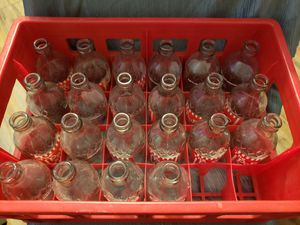 Pop shoppe bottles and crate for Sale in Sedgwick, KS