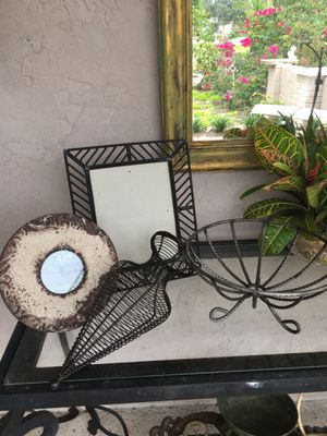 All metal black large picture frame, twisted metal compote , metal plant holder and new cream distressed round metal frame for Sale in Rotonda West, FL