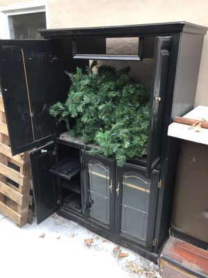 Black tv stand with DVD or game holders (not Christmas tree) for Sale in Modesto, CA