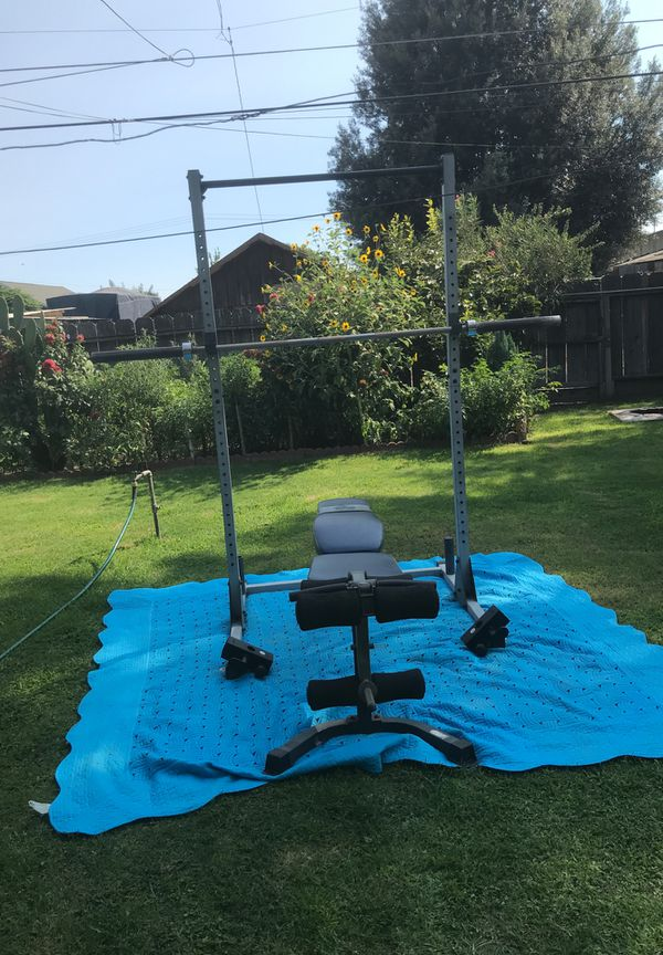 Olympic rack with bench and bar check out my page I got more