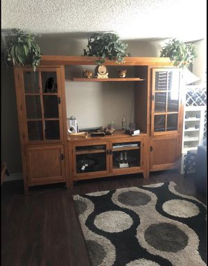 Tv Stand with bookshelves tv width is 55 and height tv height is 45 inches for Sale in Westminster, CO