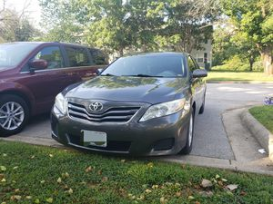 Toyota Camry 2010 with tan window back up camera and tough screen radio for Sale in Saint Robert, MO