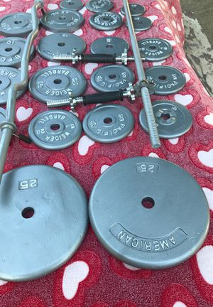 Weights and bars and dumbbell bars and clamps in real good condition no rust just like new 180lb for Sale in Cutler, CA