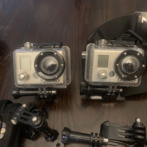 2 Go pro hero 1 Action cameras With A Ton Of Accessories for Sale in Miami, FL