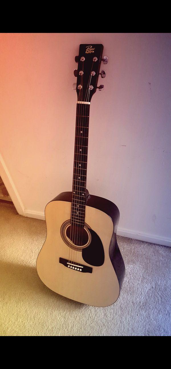 Acoustic guitar (Rogue) with guitar bag