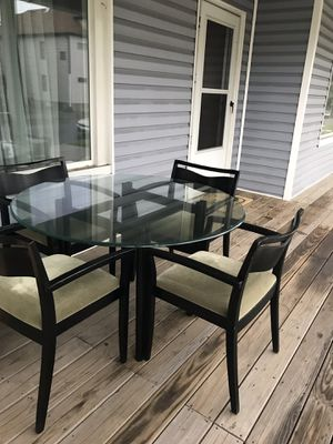 dining room set! 4 chairs in good condition !! $ 15 each and the table is free for the reason that it has 2 broken glass edge as you can see in the p for Sale in East Chicago, IN