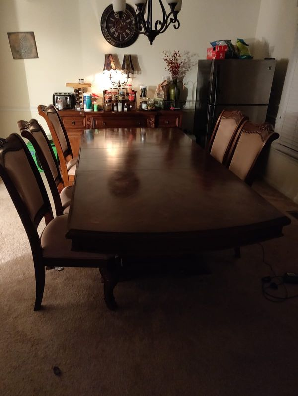 Wood dining table and buffet with chairs for 8