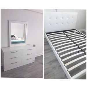 New queen bed frame and mirror dresser mattress is not included for Sale in Delray Beach, FL