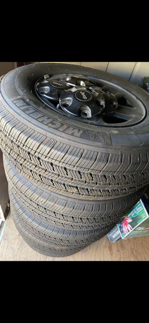 4 wheels tires Michelin 245 75 17 great condition new factory Jeep mopar for Sale in Hesperia, CA