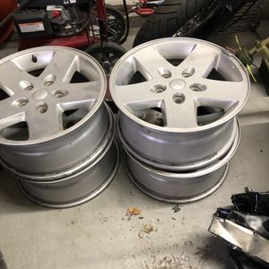 """5 Jeep Wrangler Wheels 17"""" One Has a Tire for Sale in Brighton, CO"""