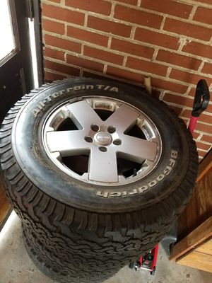 Jeep Wrangler wheels and tires for Sale in St. Louis, MO