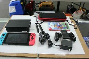 Nintendo Switch 32GB Gray Console with Neon Red and Neon Blue Joy-Con Bundle for Sale in Orangeville, UT