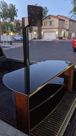 LIKE NEW TV STAND VERY SOLID AND HEAVY , THICK STAINED GLASS , HARDWOOD for Sale in Las Vegas, NV