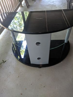 Stand tv. Table for Sale in Douglasville, GA