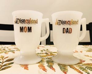 Pair of vintage white glass footed Disneyland Mom & Dad Mugs for Sale in Huntington Beach, CA