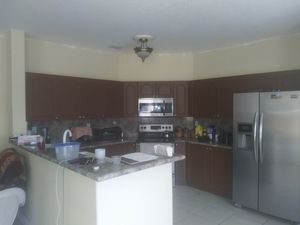 Kitchen cabinets counter top and double sink all sold for 750.00 firm for Sale in Miami, FL