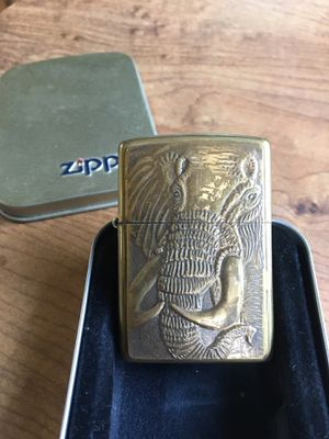 Collectible elephant zippo gold great condition for Sale in Wesley Chapel, FL