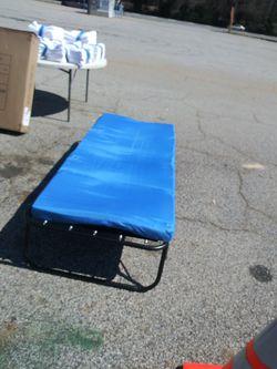 Twin Size Foldings Bed Frame & Thin Blue Mattress For $45.00 for Sale in Jonesboro,  GA