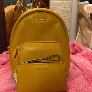 Michael Kors Mustard Backpack and Wallet Set for Sale in Colton, CA