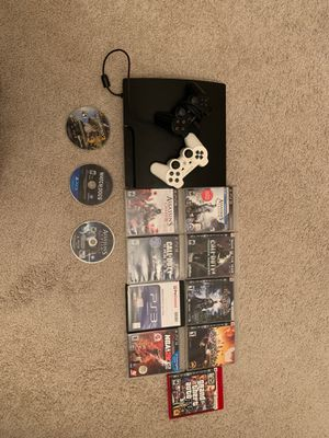 PS3 console (w/ 2 controllers, controller charging wire, and 12 PS3 games) for Sale in Des Plaines, IL