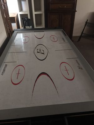 Air hockey , pool table with pool sticks and balls for Sale in Ferguson, MO