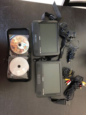 Dual Car DVD player with dvds for Sale in Irvine, CA