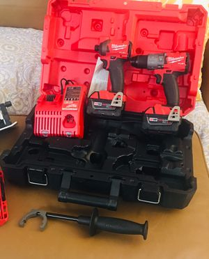 Brand new in box Milwaukee drill set includes hammer drill, impact driver, 2 batteries, drill bit set, charger and case for Sale in Homestead, FL
