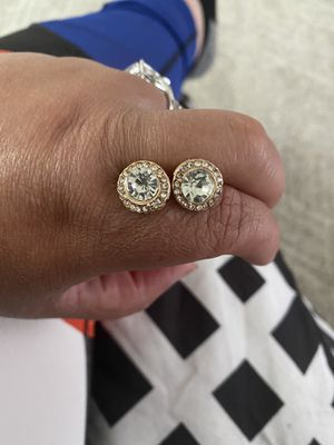 Diamond earrings with gold around them for Sale in Columbus, OH
