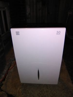 Kenmore White and black dehumidifier for Sale in St. Louis, MO
