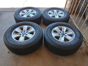 265 70 17 good set tires with rims Ford f150 expedition 6 lugs tires good year wrangler have good tread left for Sale in Phoenix, AZ