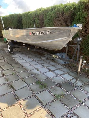 16 ft aluminum boat and motor and jet ski both run great water ready and fish ready for Sale in Portland, OR