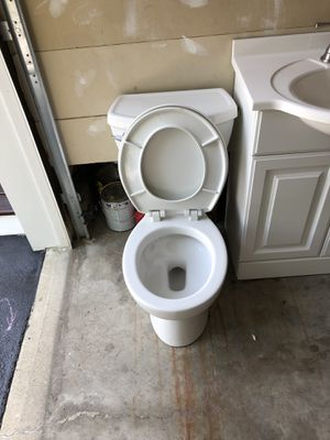 Toilet & vanity for Sale in Elmira, NY