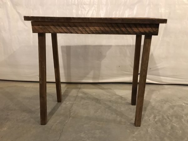 Farmhouse side table made with old barnwood.